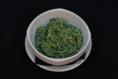 Saute baby spinach with cream royalty free stock photo