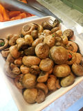 Saute button mushrooms. Beautiful shot of saute button mushrooms in hotel Stock Images
