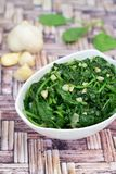 Saute garlic spinach. Homemade sautéed garlic spinach Royalty Free Stock Photos