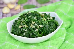 Saute garlic spinach. Homemade sautéed garlic spinach Royalty Free Stock Images