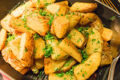 Saute Herbed Potato in a pan Stock Photo