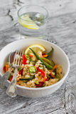 Saute with rice and vegetables in a white bowl Royalty Free Stock Photography