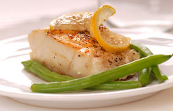 Sauted cod filet Stock Photos