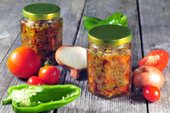 Sauted onions, tomatoes and peppers stored in glass jars for win Stock Image
