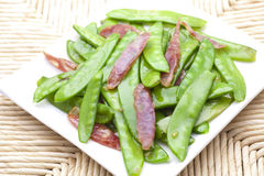 Sauted sausage and snow peas Stock Photography