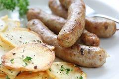 sauteed сосиски картошек стоковые изображения