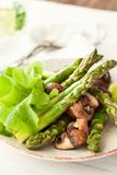 Sauteed asparagus and mushrooms Stock Image
