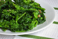 Sauteed Broccoli Rabe. Italian style sauteed broccoli rabe in olive oil and garlic royalty free stock images