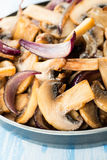 Sauteed button mushrooms in skillet Stock Images