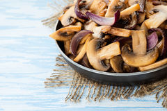 Sauteed button mushrooms in skillet. Copyspace, selective focus Royalty Free Stock Photos