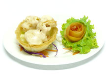 Sauteed crystal prawns with salad sauce in taro nest Stock Photography