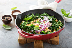Sauteed kale with chickpeas and red onion royalty free stock photo