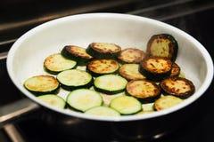 Sauteed organic zucchini squash in a frying pan Royalty Free Stock Photos