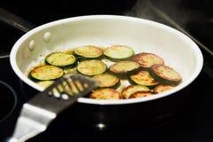 Sauteed organic zucchini squash in a frying pan Stock Image