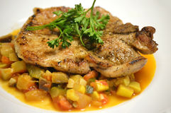 Sauteed Pork Chop with Ratatouille Royalty Free Stock Photography