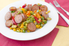 Sauteed sausages and vegetables bright Stock Image