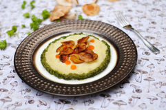 Sauteed shiitake with mashed potatoes and basil sauce Stock Photos
