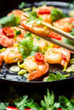 Sauteed shrimp on chopsticks Royalty Free Stock Photography