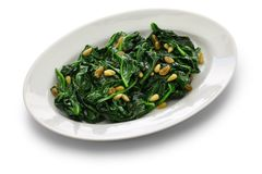 Sauteed spinach with raisins and pine nuts, catalan spinach stock photos