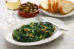 Sauteed spinach with raisins and pine nuts, catalan spinach stock photography