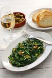 Sauteed spinach with raisins and pine nuts, catalan spinach royalty free stock photo