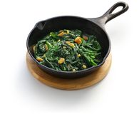 Sauteed spinach with raisins and pine nuts, catalan spinach stock images