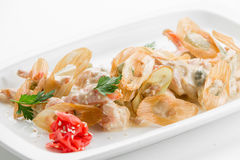 Sauteed tiger prawns in a sauce Ber Blanc on white plate backgro Stock Photography