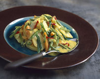 Sauteed vegetables with curry and coconut Stock Photo