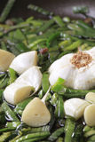 Sauteing green onion and garlic Stock Image