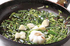 Sauteing green onion and garlic Stock Photos