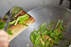 Sauteing Japanese spinach Royalty Free Stock Photography