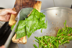 Sauteing Japanese spinach Stock Photos