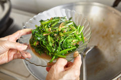 Sauteing Japanese spinach Royalty Free Stock Photo
