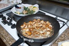 Sauteing Nantucket Bay Scallops Royalty Free Stock Images