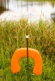 Sauveteur par un lac Photographie stock