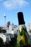 Sauvignon Blanc bottle against Auckland skyline Royalty Free Stock Photo