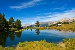 Sauze d'Oulx - Laune Lake. A scenic view of the lake and the Alps in Valle Susa, Piedmont, Italy Royalty Free Stock Photos