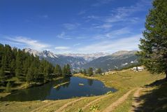 Sauze d'Oulx - Laune Lake. A scenic view of the lake and the Alps in Valle Susa, Piedmont, Italy Stock Photo