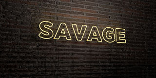 SAVAGE -Realistic Neon Sign on Brick Wall background - 3D rendered royalty free stock image Royalty Free Stock Image