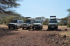 Savana landscape with safari jeeps Royalty Free Stock Photos