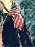 American flags fly on a facade in Savannah, Georgia - USA. Savannah, a coastal Georgia city, is separated from South Carolina by the Savannah River. It's known Royalty Free Stock Photos