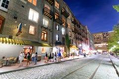 SAVANNAH, GA - APRIL 2, 2018: Tourists enjoy city streets at night. Savannah hosts 15 million tourists annually royalty free stock images