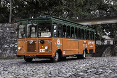 Savannah Georgia Trolley in Historic District. A trolley is parked on the cobblestone riverfront in Savannah Georgia's historic district Royalty Free Stock Photo