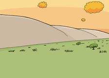 Savannah and Mountainside at Sunset. Cartoon grassland savannah with hillside during sunset Royalty Free Stock Images