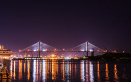 Savannah Night Bridge. A view of bridge in Savannah Georgia in the USA United States at night with light reflections in the water way Royalty Free Stock Image