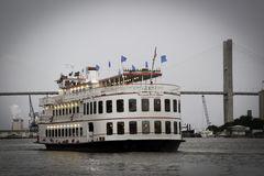 Savannah Riverboat. A riverboat moving down the Savannah River in Georgia; the Talmadge  Memorial Bridge is seen in the background; the Savannah Riverboat Stock Photos