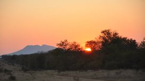 Savannah Sunset, Zimbabwe. Sunset on the Bubye Valley Conservancy in Zimbabwe, Towla mountain is on the left Stock Photos