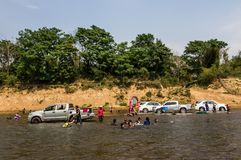 Car join songkran festival. SAVANNAKHET,LAOS-APRIL 16,2018 : Cars in the river  to celebrate  Songkran festival in Savannakhet,Laos on April 16,2018.Songkran Royalty Free Stock Image
