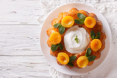 Savarin French dessert with apricots and whipped cream. horizont Stock Photo