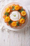 Savarin French dessert with apricots and whipped cream. vertical Stock Image